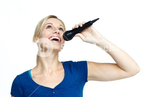 Woman singing on a microphone against white background