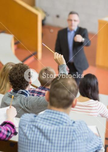 Students with teacher at lecture hall
