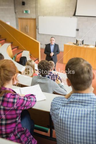 Teacher with students at the lecture hall