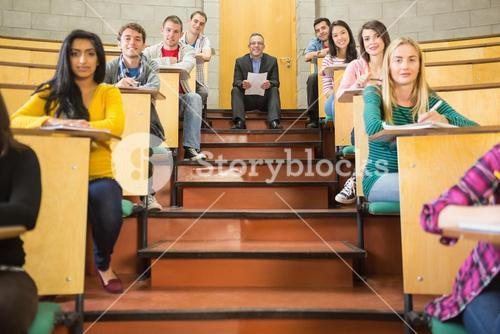 Elegant teacher with students sitting at the lecture hall