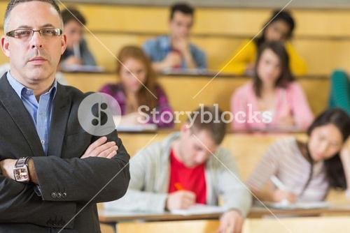 Portrait of an elegant teacher with students at lecture hall
