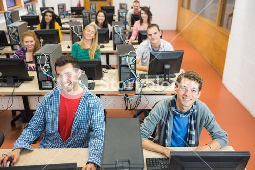 Smiling students in the college computer room