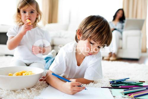 Cute little gir eating chips and her brother drawing