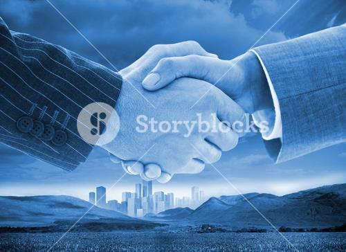 Business handshake on background of buildings and landscape