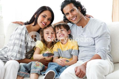 Cheerful family watching TV together