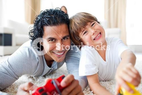 Animated little boy and his father playing video games