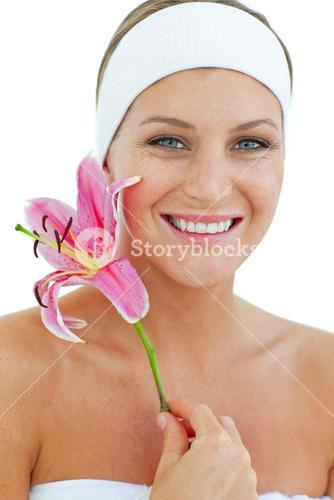 Delighted woman smelling a flower