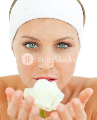 Radiant woman holding a white rose