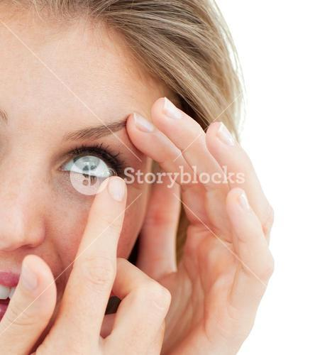 Close up of a woman putting a contact lens