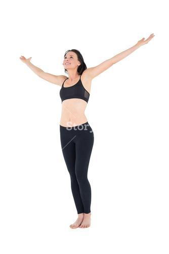 Full length of a sporty woman with hands outstretched