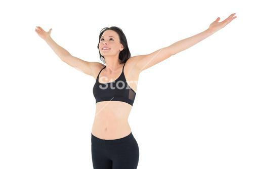 Sporty young woman with hands outstretched