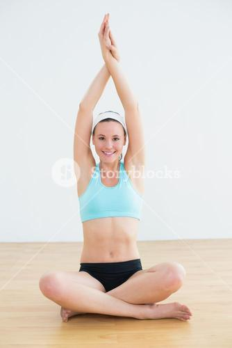 Sporty woman in Namaskar pose with twisted hands