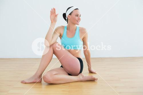Fit young woman doing the spine twisting pose