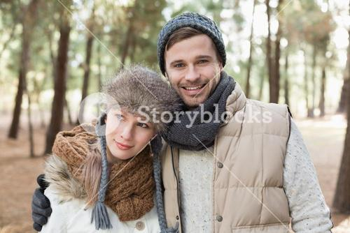 Couple in winter clothing in the woods