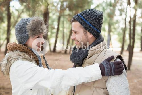 Couple in winter clothing looking at each other