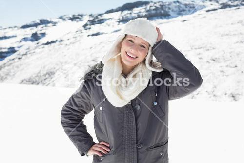 Woman in warm clothing on snowed landscape