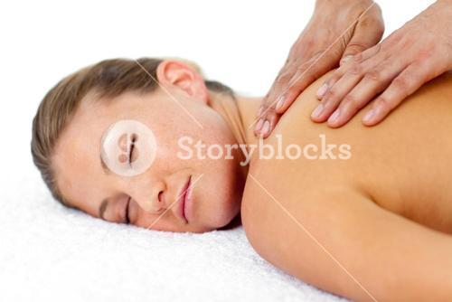Relaxed woman getting a spa treatment