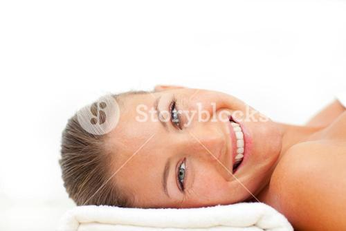 Portrait of cheerful woman relaxing after a spa treatment