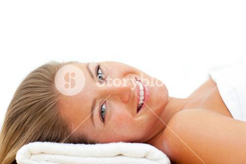 Portrait of attractive woman relaxing after a spa treatment