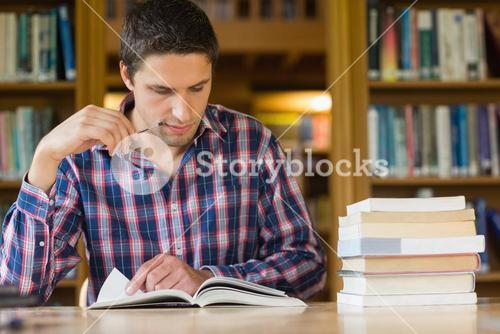 Mature student studying at desk in the library