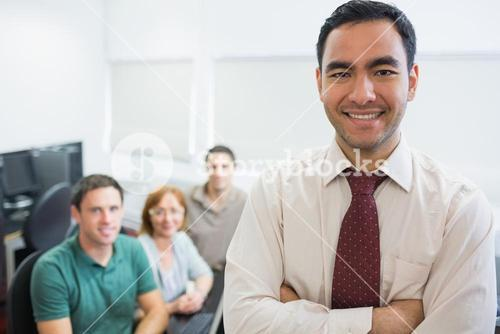 Teacher with mature students in computer room