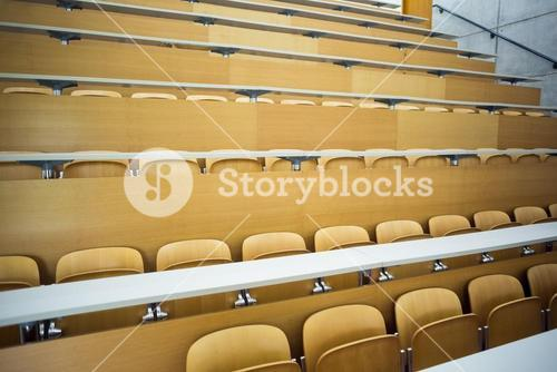 Empty seats with tables in a lecture hall
