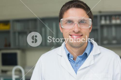 Close up of a confident male doctor wearing surgical glasses