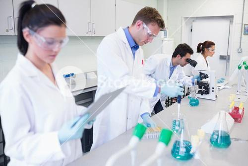 Researchers carrying out experiments in the lab