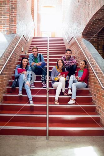 College students sitting on stairs in the college