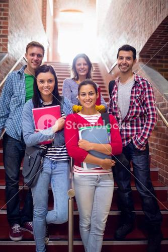 College students standing on stairs in college