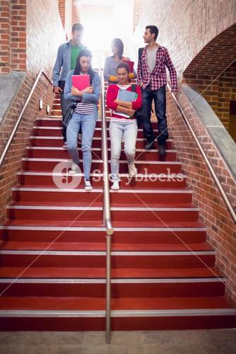 College students walking down stairs in college