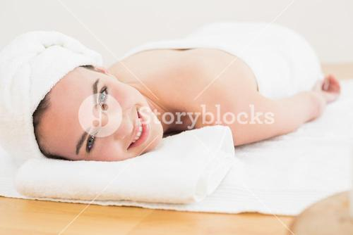 Beautiful young woman resting at beauty spa