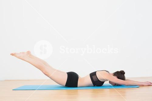 Sporty woman doing the Locust Posture