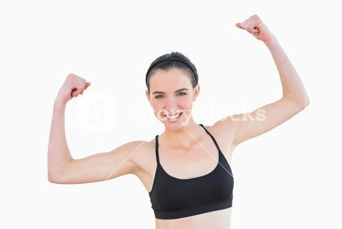 Portrait of sporty fit young woman clenching fists