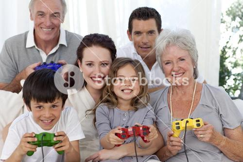 Grandparents, parents and children playing video games