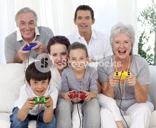 Family playing video games at home