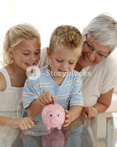 Close up of grandmother and children saving money