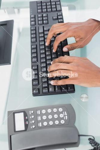 Hands using computer at medical office