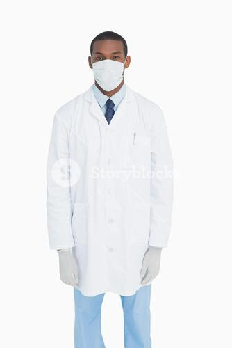 Portrait of male doctor wearing mask and gloves