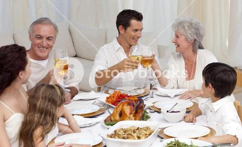 Parents and grandparents tusting with wine in a dinner
