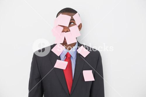 Young Afro businessman covered in blank notes