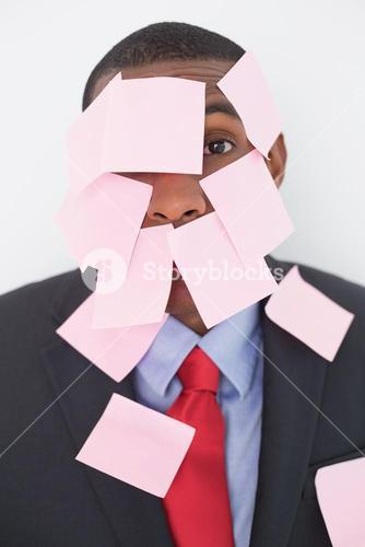 Close up portrait of Afro businessman covered in blank notes