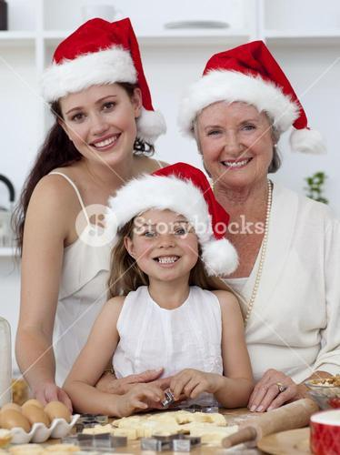 Daughter, mother and grandmother baking Christmas sweets
