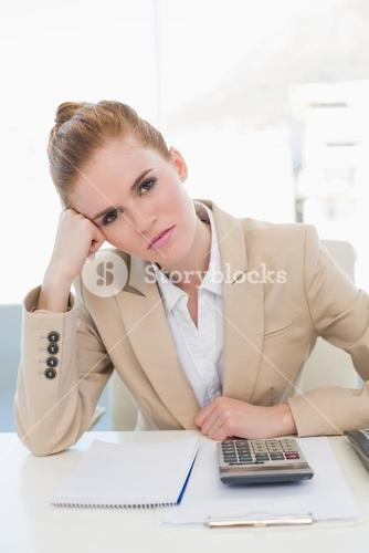 Tired businesswoman sitting at office desk