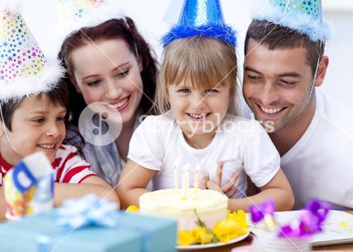 Parents and children celebrating a birthday