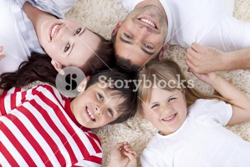 Family on floor with heads together