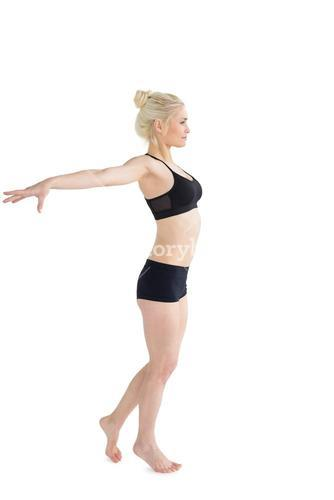Full length of a sporty young woman stretching out hands