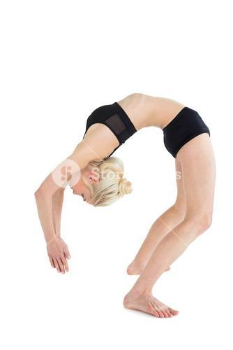 Fit young woman bending backwards