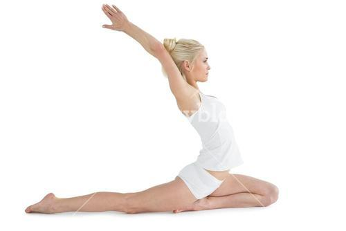 Toned young woman stretching hands backwards