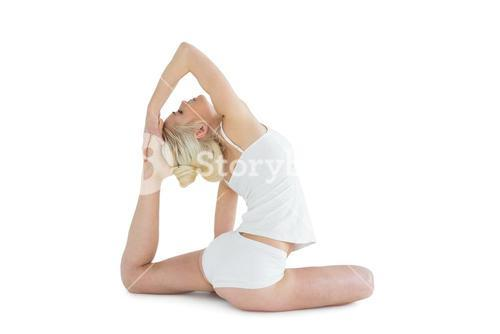 Side view of toned woman doing the pigeon pose